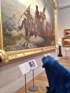 Cookie Monster admiring  Emanuel Leutze's monumental 1851 painting, Washington Crossing the Delaware, at the Metropolitan Museum of Art.